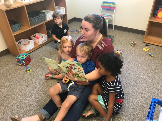 Elizabeth Vargas reads to three children in the Oconee Street UMC nursery on Sunday, while their parents attend church.