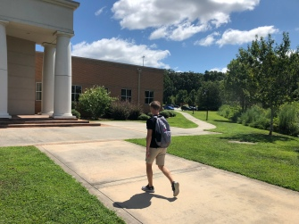 Senior Bryce Griggs heads to class in the Swanson Center.