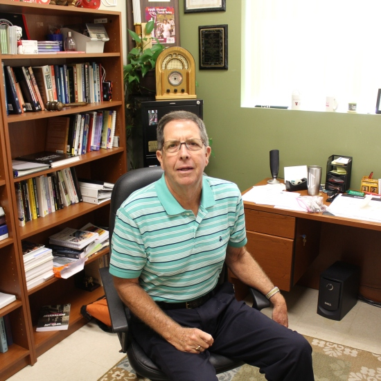 Dr. Dale Van Cantfort, a mass communications professor at Piedmont, wears the hell out of that polo. PHOTO: Nate Roys