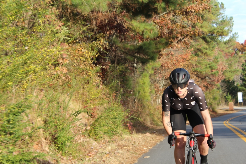Senior Biology Major Madeline Pierce going on her daily training ride on Smith Loop Road off Piedmont's campus. To maintain her phenomenal track record and professional contract, she works on her like this every day, modeling excellence.
